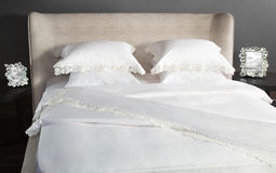 Linen white color on a beautiful bed Stock Photos