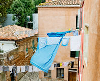 Linens and clothes dries outdoor. stock photography
