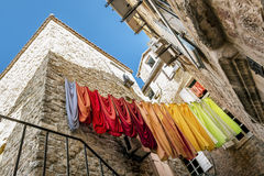 Linens dried in the streets of the old town of Budva Stock Photography