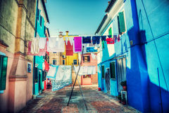Linens dry outdoors. Linens drying outdoors on Venice Italy street. Vibrant hdr style colors Royalty Free Stock Images