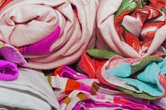 Linens rolled rolls piled stacks in a closet, cabinet furniture. For home interior, home textile wash and proutyuzhenny, colorful, soft focus Royalty Free Stock Photos
