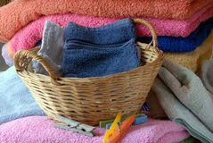 Linens with a wicker basket royalty free stock images