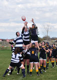 A Lineout in a Women's College Rugby Match. A lineout in a women's collegiate rugby match between Navy and the Brigham Young University (BYU) Cougars in the NCAA Stock Image