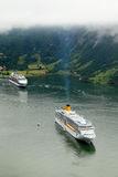 Liner Costa Luminosa floats in fjords Royalty Free Stock Image