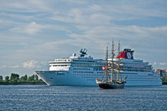 Cruise Ship and Sailship. Big cruise ship Zenith leaving and Danish fullrigger Georg Stage entering harbour of Saint Petersburg in Russia Stock Image
