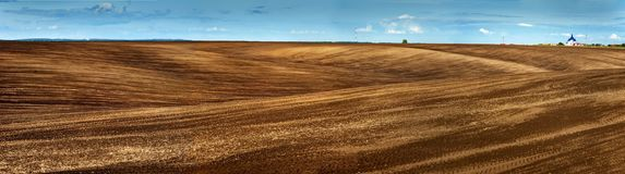 Lines of arable land landscape panorama. Lines of arable land landscape panoramic view Royalty Free Stock Photos