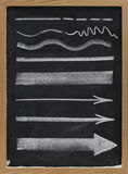 Lines and arrows - white chalk on blackboard Stock Photography