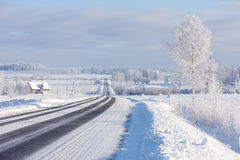 Lines asphalt winter road through rural field on the horizon Stock Photos