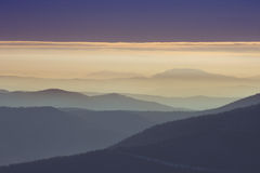 Lines of beautiful mountains in fog Stock Photo