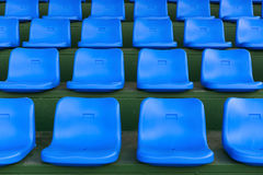 Lines of blue stadium seats horizontal. Composition stock photography