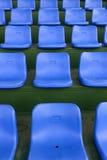 Lines of blue stadium seats Royalty Free Stock Image