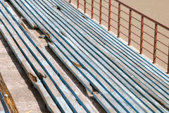 Lines of broken blue benches. stock image