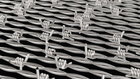 Lines of Chrome Barbed Wire on Black Royalty Free Stock Image