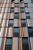 Lines and contrasts. A view on the windows of an office building with colorfull panels Royalty Free Stock Photo