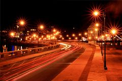 Luminous flow of cars. Lines describing the flow of traffic on the road. Time Delay Stock Photos