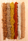 Lines of different spices. From left to right: cinnamon, coriander, curry, paprika, white pepper, nutmeg Royalty Free Stock Photography