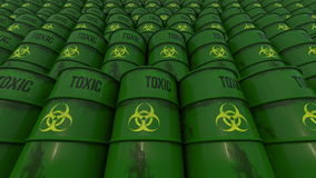 Lines of green barrels with toxic content. Low angle view. 4K seamless loopable animation, ProRes. Line of green barrels with biohazard content. 4K seamless royalty free illustration