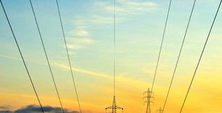 Lines of hanging cables and electrical towers Royalty Free Stock Photos