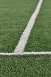 Lines intersect on a turf field of play. Stock Photo