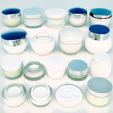 Lines of jars of daily beauty creams. The view from the top Stock Photo