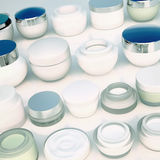 Lines of jars of daily creams. Royalty Free Stock Image