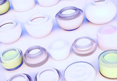 Lines of jars of daily creams. The view from the top. Lines of jars of daily beauty creams. The view from the top. Horizontal Stock Photos
