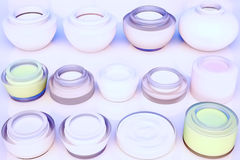 Lines of jars of creams. The view from the top. Royalty Free Stock Photo