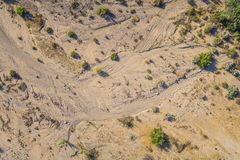 Creek Line in Desert. Lines left in a sandy creek bottom mark the passage of water through a desert wash Royalty Free Stock Photo