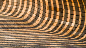 Lines, Light, Shadows, and Curves. Abstract created by light and shadows on a curve wood-tiled surface Stock Images