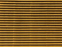 Lines of metallic air vents. Line pattern of yellow metallic air vents background stock photography