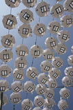 Lines of paper lampshades. On a blue sky background Stock Photography