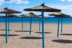 Lines of Parasols at Spanish Sand Beach Royalty Free Stock Image