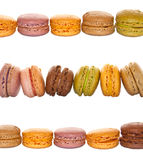 Lines of pastel colored french macarons Stock Photography