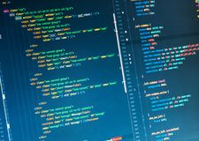 Lines of php code on the monitor on blue background, close up royalty free stock image