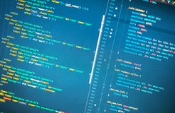 Lines of php code on the monitor on blue background. Close-up stock image