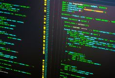 Lines of php code on the monitor on dark background, close up. Programming concept. Lines of green php code on the monitor on dark background. Macro royalty free stock photography