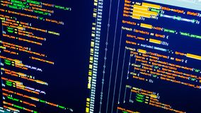 Lines of php coding on the screen. Orange code on dark blue background. Web developing stock photos