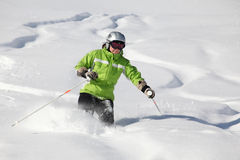 Lines in powder snow. Female skier in powder snow with more tracks from skiing Stock Photos