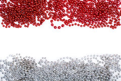 Lines of red and silev beads garland thread isolated on white Royalty Free Stock Photo