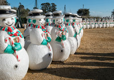 Lines of snowmen ready for the holidays Royalty Free Stock Photos