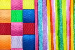 Lines and squares of colors. Close up abstraction of lined colored paper and squares of woven materials Royalty Free Stock Photos
