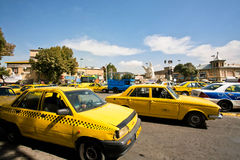 Lines of taxi cars of yellow color in Middle East. Royalty Free Stock Photography