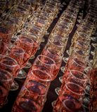 Lines of wine glasses. Lines of chilled wine glasses at a wine tasting event Stock Photo