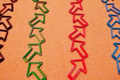 Lines of Zigzag Arrows. Lines of zigzag arrow paperclips in black, green, pink, and blue stock images