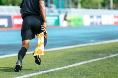Linesman. Linesman with flag running on football yard Stock Images