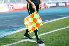 Linesman. Linesman with flag Standing on football yard Stock Photos