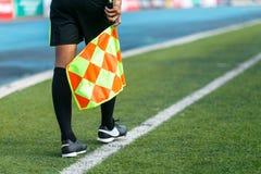Linesman. Linesman with flag Standing on football yard Stock Photo