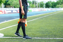 Linesman. Linesman with flag Standing on football yard Royalty Free Stock Images