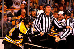 Linesman Shane Heyer separates two players. Royalty Free Stock Image