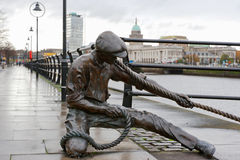 The Linesman statue. Dublin, Ireland. The Linesman statue situated on the bank of the River Liffey in the Financial district. Dublin, Ireland Royalty Free Stock Images